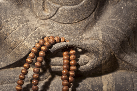 © Delstudio | Dreamstime.com - Close Up On A Buddha Statue Hands Holding A Wooden Prayer Beads Rosary Photo